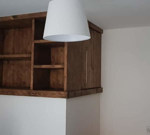 A custom built bedroom reclaimed timber storage unit with a 1m pull out drawer for a client in Tideswell, Derbyshire.