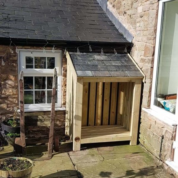 A custom made log store with a reclaimed slate roof for a client in Marple, Cheshire.