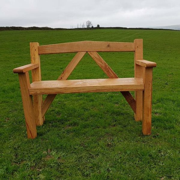 A commissioned green oak bench for a client in Macclefield, Cheshire