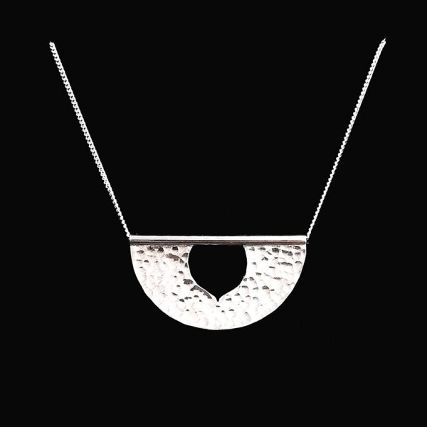 iluna designs, 3.5cm wide silver pendant on chain, the pendant has a hammered finish for high shine and sparkle, the chain flows freely through the tube at the top of the pendant