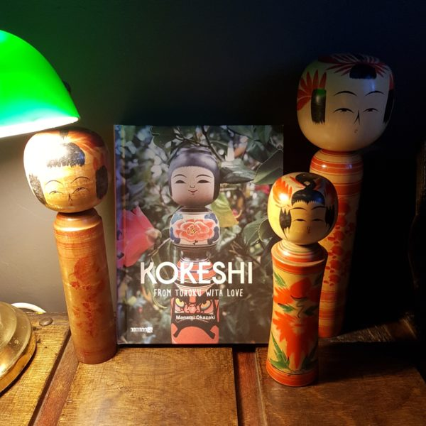 Vintage Whatnots - Japanese Kokeshi and Book on Mill Cart Table