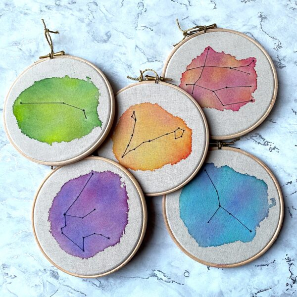 Five embroidery hoops. Watercolour constellations