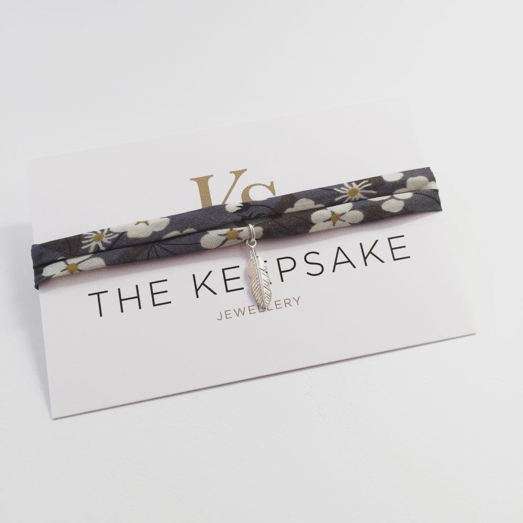 The Keepsake. Pedddle, feather, charm bracelet, liberty wrap bracelet