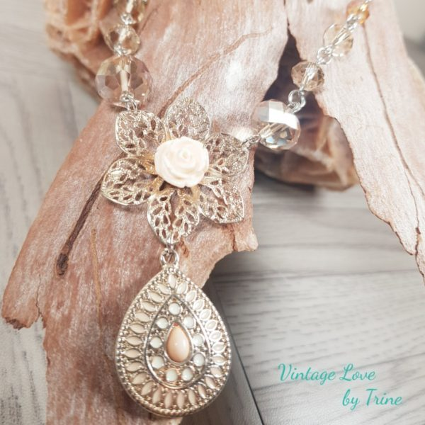 Handmade silver tone vintage style necklace with silk and peach Swarowski crystal beads and a filigree flower with and a rose enamel teardrop pendant.