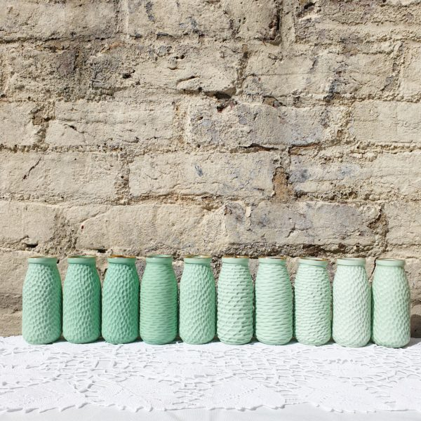 Green porcelain carved bottle vases by Clara Castner