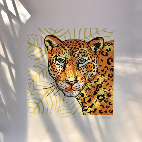 The Littlest Falcon - Yellow Jaguar - original linocut print of a jaguar in bright yellow and orange with black spots