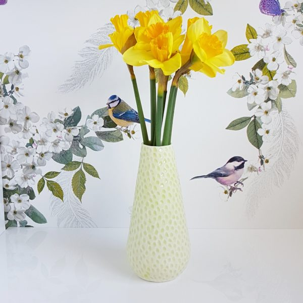 Charlotte vase with lime green glaze and daffodils by Clara Castner