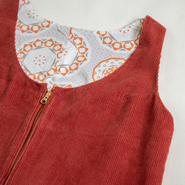 Detail of handmade pinafore dress and lining