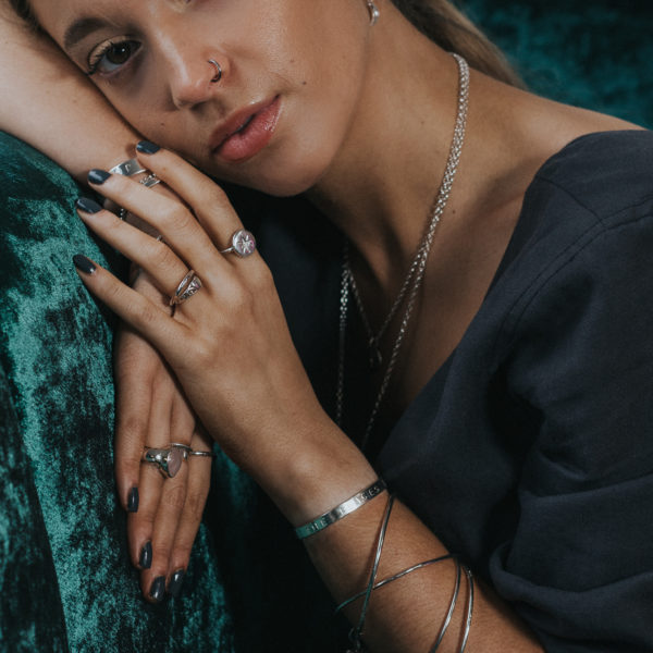 evie models bangles, rings and earrings