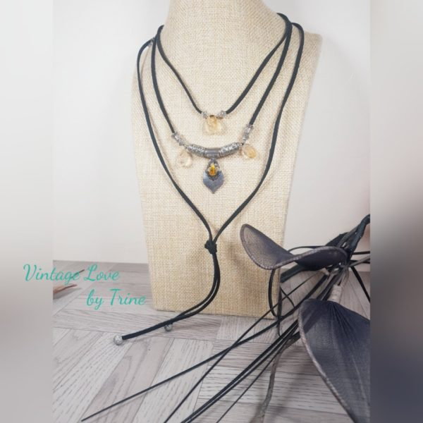 Handmade faux black suede triple strand choker with a silver tone pendant, citrine crystals and metal beads and longer knot cord to finish.