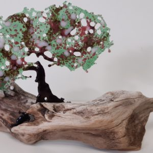 Stiltwalkers Stuff, fused glass tree with pale pink blossom mounted on driftwood