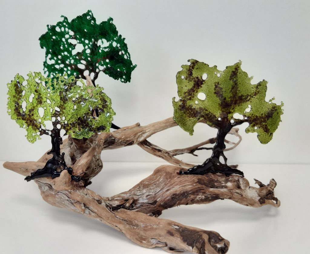 3 fused glass trees mounted on a large piece of driftwood