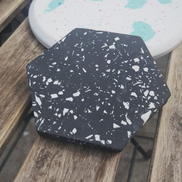 black hexagon terrazzo coaster with white flecks