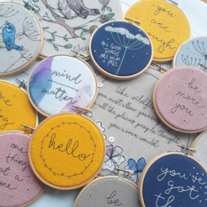 Collection of embroidered motivational embroidery hoops in varioua colours