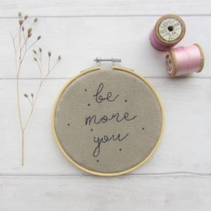 "Be more you embroidered quote set in a 4"" embroidery hoop on natural coloured fabric - Laced Wing Designs"