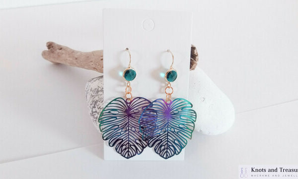 Knots and Treasures, Iridescent Monstera Leaf with Blue Glass Gold Earrings