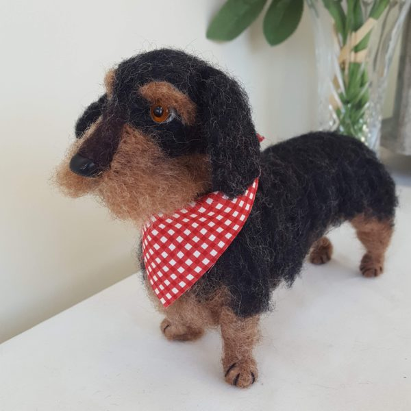 Needle felted model of a wire haired dachshund for decorative purpose