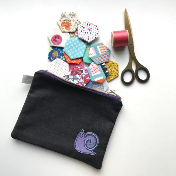 Zipped Purse featuring a smiley snail patch