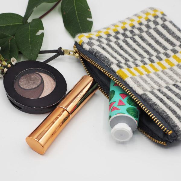 Handmade striped purse for makeup storage