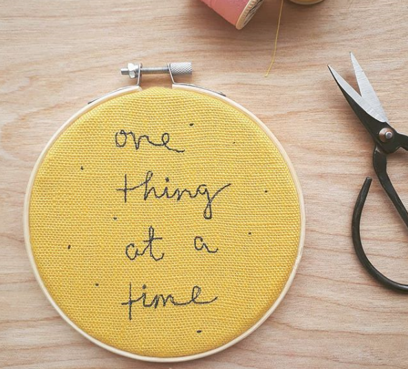 """One Thing at a time - embroidered sewn quote on a mustard linen set in a 4"""" embroidery hoop - Laced Wing Designs"""