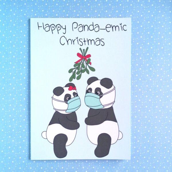 Peach and Mimi, Happy Panda-emic Christmas Card, Digitally illustrated image of 2 panda's wearing masks under the mistletoe
