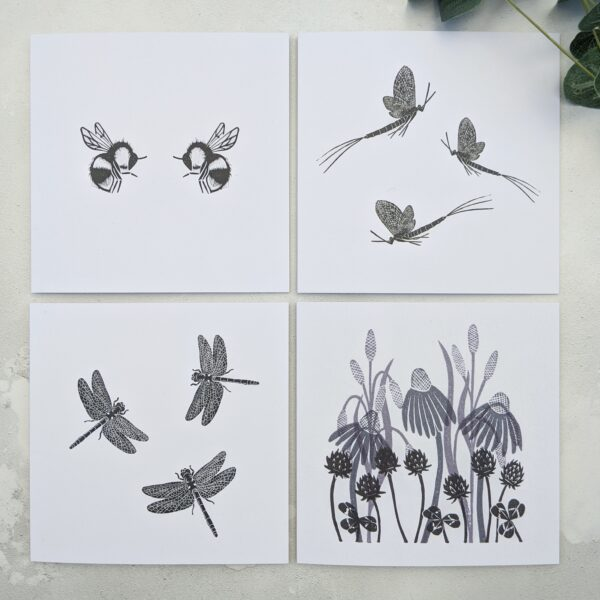 Rose and Hen, 4 greetings cards in black and white. One with two bees facing each others, one with two mayflies, one with three dragonflies and one of meadow grass, daisies and clover.