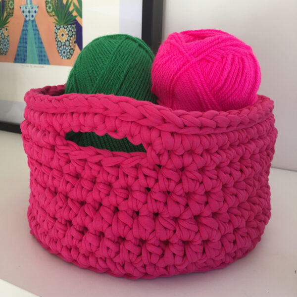 Crochet basket made with upcycled tshirt yarn, bright pink