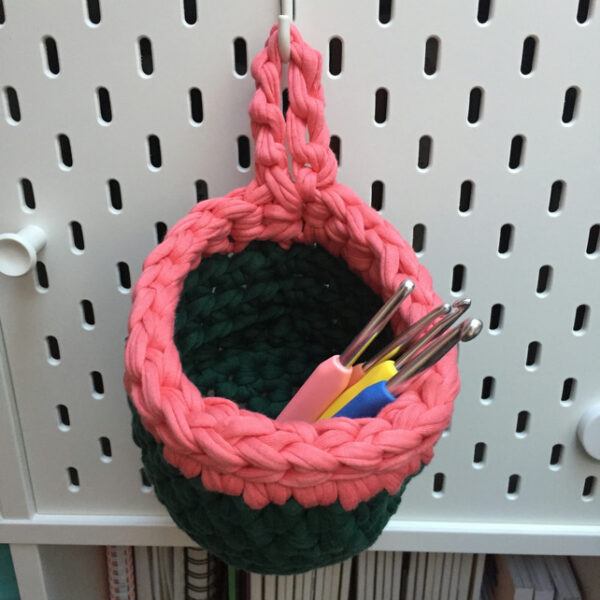Small crochet pegboard basket, green and coral