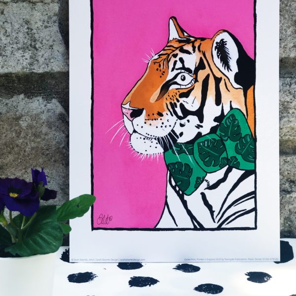 Sarah Downes Design Fine Art A4 print of Tiger wearing a green with dark leaves bow tie on a pink background
