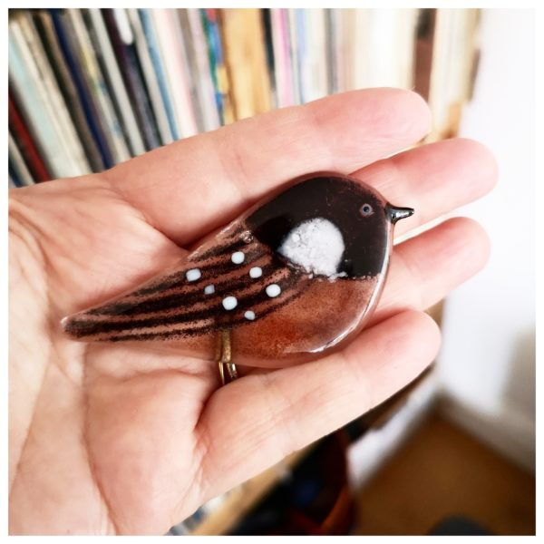 robyn coetzee glass designs, coal tit cupped in a hand, decorative coal tit for hanging in your windown