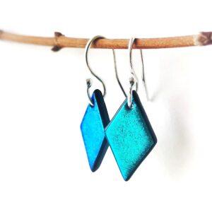 diamond dangle peacock blue earrings, robyn coetzee glass, hangin from a branch