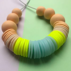 Nine Angels, Peach, neon yellow, pastel blue and cream polymer clay statement disc necklace
