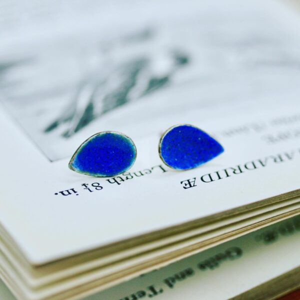 Platina jewellery, sterling silver leaf shaped studs with a bright lapis blue enamel.