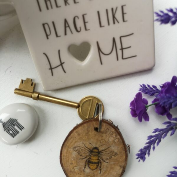Ivy Upcycling Bee key ring made from natural wood with bark edging and Bee motif with strong metal ring for keys