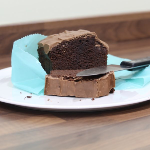 Sweet Bee Wraps UK blue wax wrap half chocolate cake unwrapped with slice