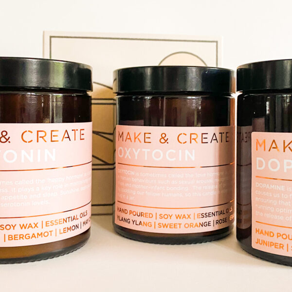 Group of pink labelled soy wax candles