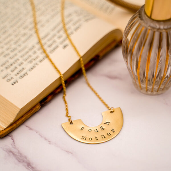 picture of brass pendant necklace with words Tough Mother