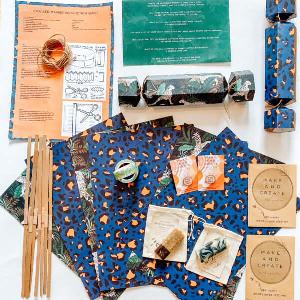 flat lay of eco friendly cracker kit with templates and gifts