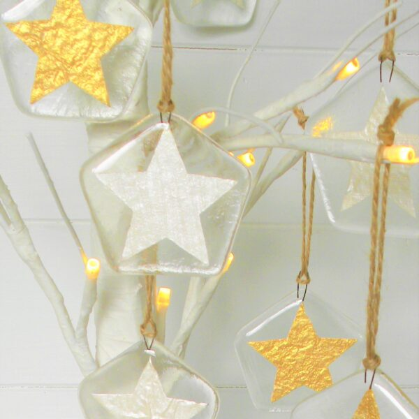 Glass at the Spinney, Gold and Silver star Christmas decorations hanging from a white birch tree with twine thread
