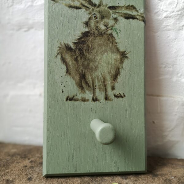 Ivy Upcycling Country Hare Wooden Peg Hook. Made from waste wood painted in heritage green with beautiful hare illustration decoupaged onto the face. One hand turned wooden peg hanging hook.