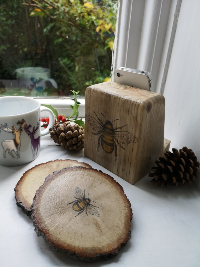 Gift Set of 2 Wooden Bark Coasters with Bee decoration and Wooden Phone or Tablet Stand with Bee Decoration. Sustainably made by hand from waste wood.