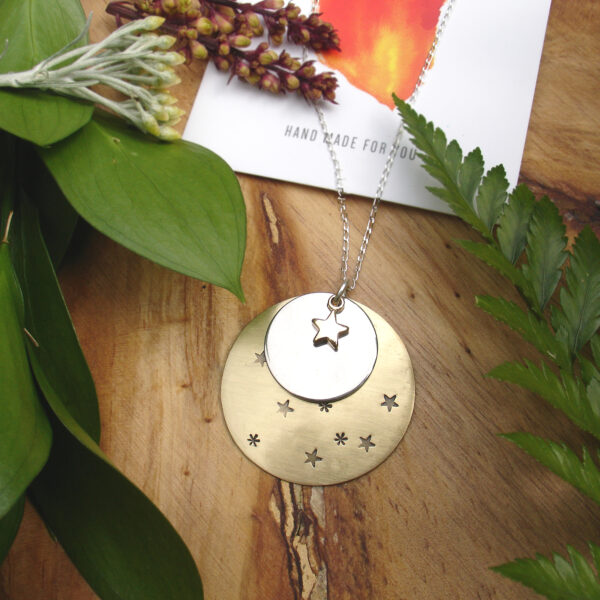 Skyla moon child zodiac necklace. Featuring a brass hand-stamped star medallion and gold-plated charm star.