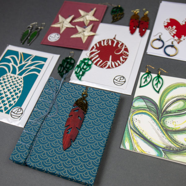 A range of Peach Plot products. Laser cut cards, jewellery and gifts.