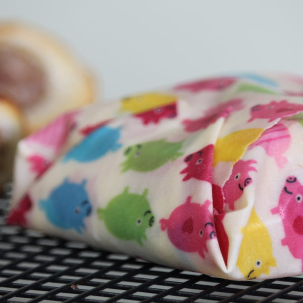 Sweet Bee Wraps UK multicolour pigs wax wrap sausage rolls wrapped with 2 sausage rolls