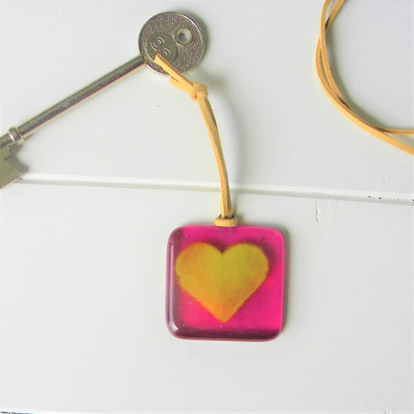 Glass at the Spinney, pink keyring with yellow heart made of fused glass with tan leather strap