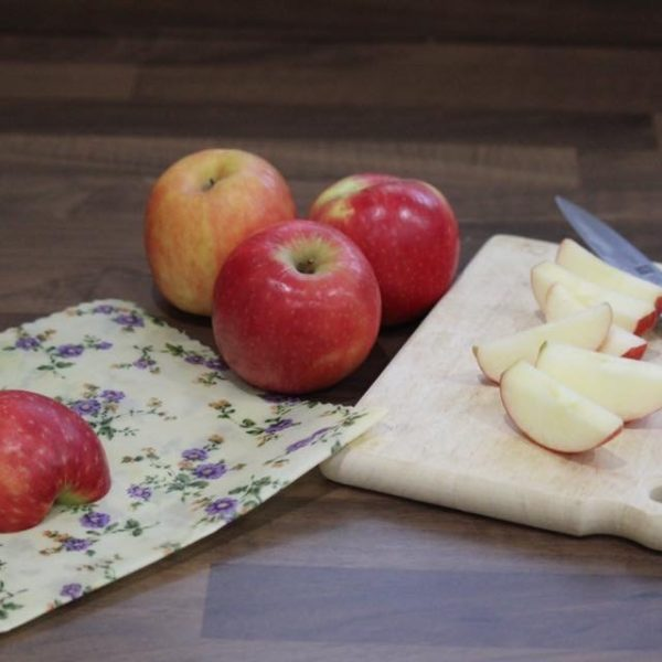 Sweet Bee Wraps UK purple flowers wax wrap with half apple sliced apple and three whole apples