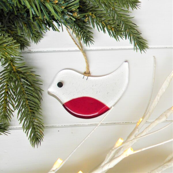 Glass at the Spinney, Christmas Robin decoration next to fir tree and fairy lights