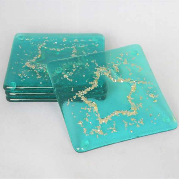 Glass at the Spinney, Sea Star Coasters in aqua fused glass with silver flakes displayed as a set of four