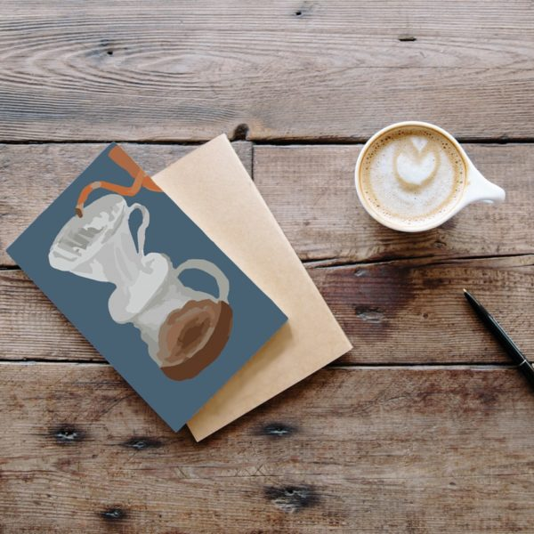 The Perfect Cup - Pour over orange on navy blue background with kraft envelope and next to cup of coffee - Coffee Inspired Cards - Sarah Anne Drawsprinted on recycled materials in Yorkshire