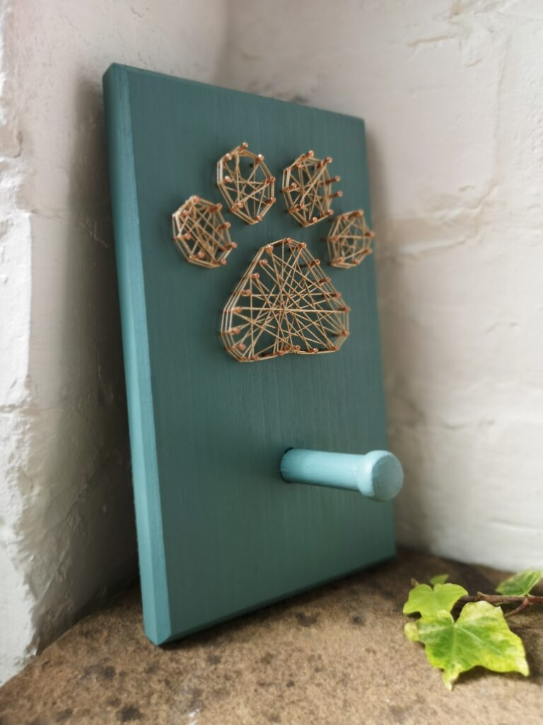 Ivy Upcycling Paw Print wooden peg hook made from upcycled wood with hand turned peg painted in sea green with gold string dog paw decoration